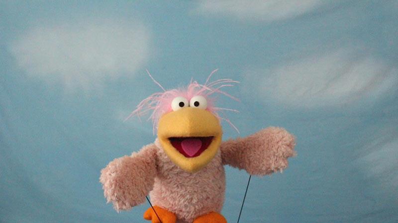 A pink Sesame Street muppet style
