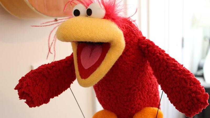 A red Sesame Street Muppet style bird puppet