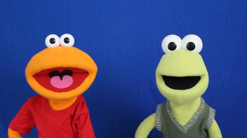 Custom orange and green puppets